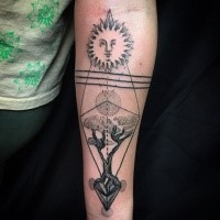 Strange looking dotwork style forearm tattoo of tree and sun
