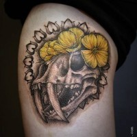 Stunning 3D like colored ancient animal skull tattoo with yellow flowers