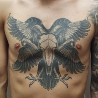 Stunning black ink animal skull tattoo on chest combined with natural looking crows