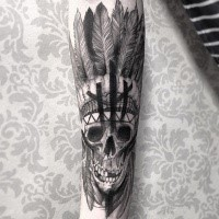 Stunning black ink forearm tattoo of Indian skull and feather