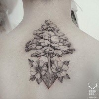 Stunning blackwork style designed by Zihwa tattoo of large tree with flowers
