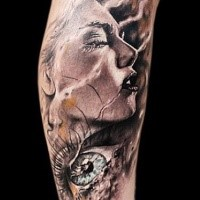 Stunning colored leg tattoo of woman face with eye