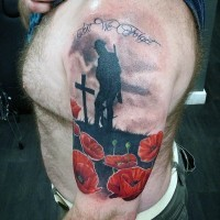 Stunning colored world war memorial shoulder tattoo with flowers and lettering