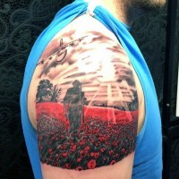 Stunning colorful field with red flowers shoulder tattoo with military motifs
