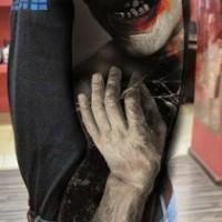 Stunning designed creepy monster vampire colored tattoo on sleeve