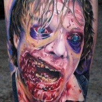 Stunning horror movie like colored bloody zombie tattoo on leg