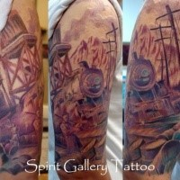 Stunning multicolored upper arm tattoo of steel train