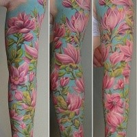 Stunning natural colored sleeve tattoo of pink flowers with leaves