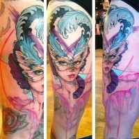 Stunning old style lady in feather butterfly shaped mask colored thigh tattoo with paint drips