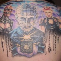 Stunning painted massive colored horror movie heroes tattoo on upper back