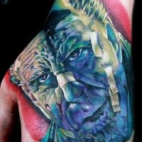 Stunning realistic looking colored hand tattoo of famous movie hero face