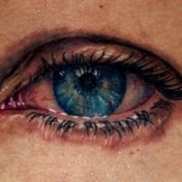 eccezionale realistico occhio triste blu tatuaggio