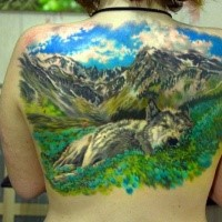 Stylish natural looking realism style upper back tattoo of wolf sleeping near mountains