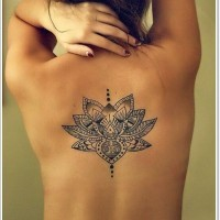Stylized black ink lotus tattoo design for women