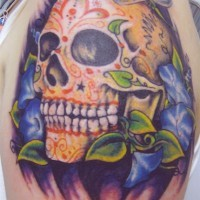 Coloured sugar skull with blue flowers tattoo