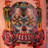 Sugar skull with burning candles tattoo
