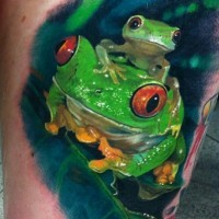 Super realistic watercolor green frogs tattoo