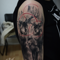 Superior black and white shoulder tattoo of deer with red circles