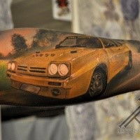 Superior designed and colored forearm tattoo of yellow race car