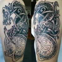 Superior painted Celtic style dragon shaped tattoo on arm