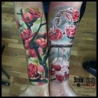 Superior realism style colored forearm tattoo of blooming tree with frozen cherries