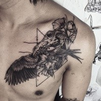 Surrealism style black ink chest tattoo of animal skull with birds and flowers
