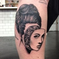 Surrealism style black ink leg tattoo of biomechanical woman face