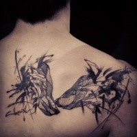 Surrealism style black ink scapular tattoo of wolf couple
