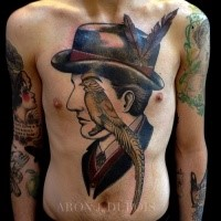 Surrealism style colored chest and belly tattoo of man with parrot