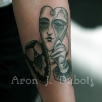 Surrealism style colored forearm tattoo fo heart shaped mask with hand