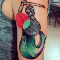 Surrealism style colored shoulder tattoo of mermaid with sword