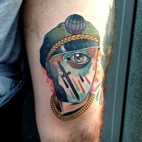 Surrealism style colored thigh tattoo of human face with eye and sword