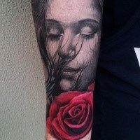Sweet looking colored arm tattoo of cute woman with red rose