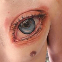 Sweet looking colored chest tattoo of beautiful human eye
