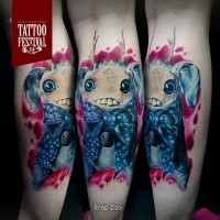Sweet looking colored leg tattoo of funny monster with horns