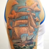 Sweet looking colored shoulder tattoo of awesome sailing ship
