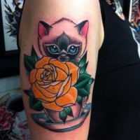 Sweet looking colored shoulder tattoo of beautiful cat with cup and rose
