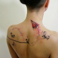Sweet looking colored upper back tattoo of paper plane with butterflies
