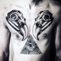 Symmetrical black ink chest tattoo of animal skulls and mystic triangle