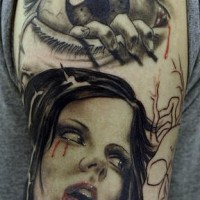 Creepy hand out of eye tattoo