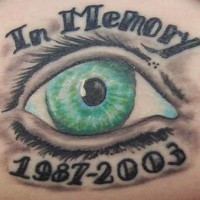 Green eyes memorial tattoo