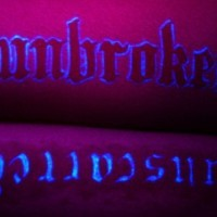 Unbroken script glowing tattoo