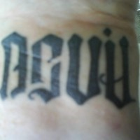 Devil ambigram tattoo on hand