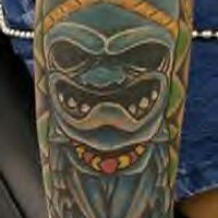 Blue indian totem deity tattoo