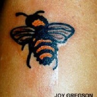 Stinger bee coloured tattoo