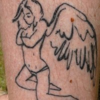 Girl with angel wings tattoo