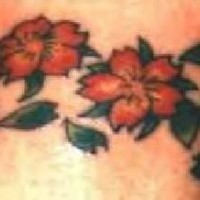 Coloured flowers armband tattoo