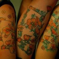 Tattoo von Mohnblumen am Arm
