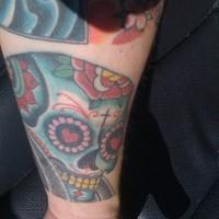 Skull in love arm tattoo