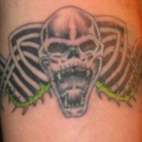 Sharp-toothed skull tribal tattoo
